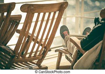Cruise Deckchair Relaxing. Men Enjoying His Vacation.