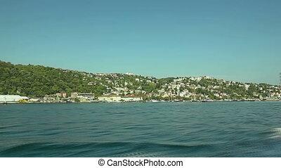 Cruise Istanbul coastal and residental buildings sailing Bosporus.