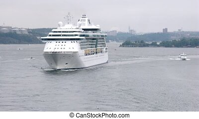 Cruise liner follow another ship in Stockholm bay, view from ship deck