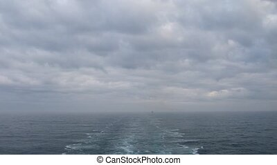 Cruise liner trace on cloudy day, time lapse