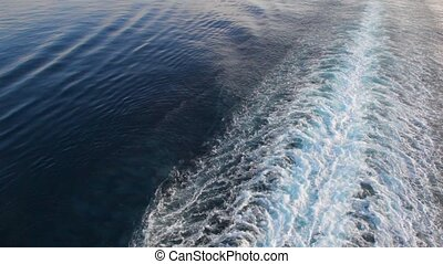 cruise liner trace on water surface of sea, top view