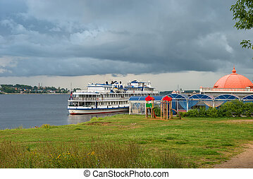 Cruise ship at the pier on the Volga river in the city of Kostroma on a summer evening