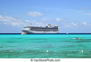Cruise ship - Beach scene with a cruise ship on the water...