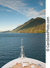 Cruise ship bow and mountain