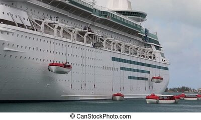 Cruise Ship Deploying Lifeboats - Modern cruise ship...
