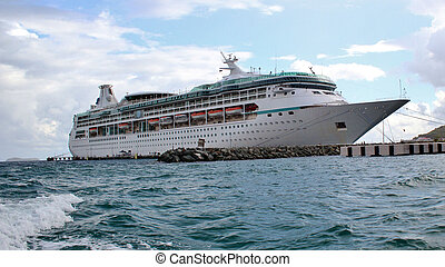 Cruise ship docked - A cruise ship docked at a tropical...
