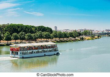 Cruise Ship Floating In Guadalquivir River In Seville, Spain...
