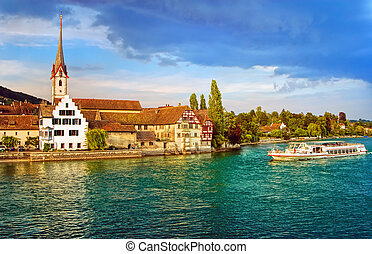 Cruise ship going down the Rhine river in Stein am Rhein,...
