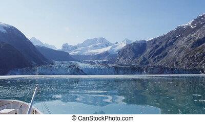 Cruise ship in Glacier Bay cruising towards Johns Hopkins Glacier in Alaska, USA. RED EPIC SLOW MOTION.