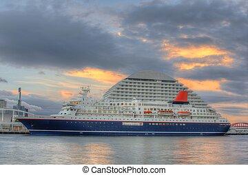 Cruise Ship - Luxury cruise ship docked near a luxury hotel.