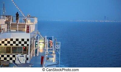 cruise ship moving in night sea