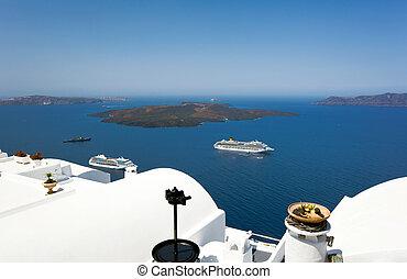 cruise ship near volcano on island of Santorini, Greece.