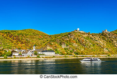 Cruise ship passes under Sterrenberg and Liebenstein Castles in the Rhine Gorge, Germany