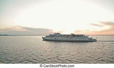 Cruise ship sailing on the river at