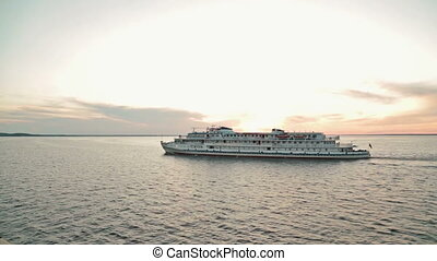 Cruise ship sailing on the river at