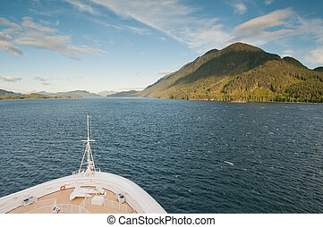 Cruise ship sailing towards mountain
