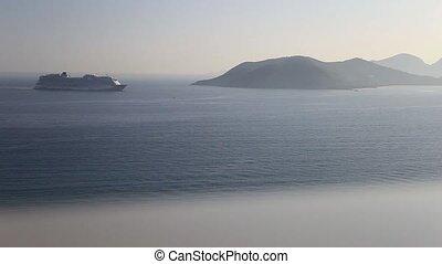 Cruise ship very far on the horizon - Cruise ship for use in...