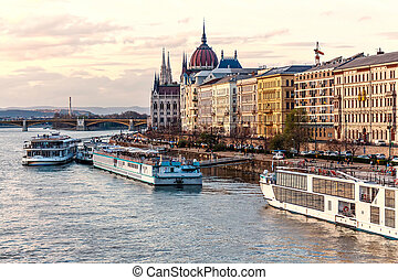 Cruise ships at sunset on Danube river