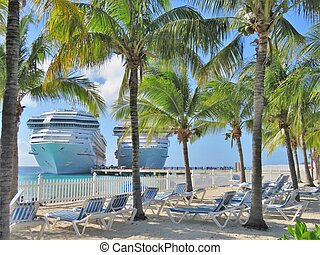 Cruise ships docked on a tropical island