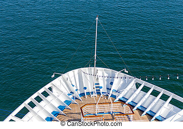 Cruise travel tourism concept - open deck with navigational equipment and pool nose ship cruise liner.