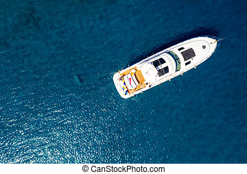 Cruise yacht at the sea, top down view