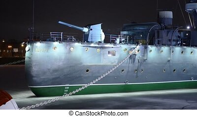 Cruiser Aurora at night in St. Petersburg. The inscription...