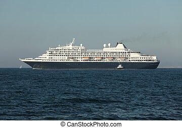 Cruiseship heading out at the sea