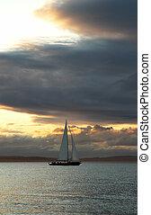 Cruising boat at sunset