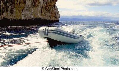 Cruising on the blue sea and the rocky coast in the gulf of Orosei, east coast of Sardinia - Italy. 20th of May 2019