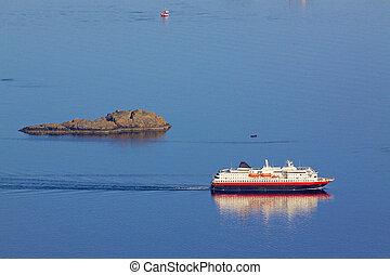 Cruising ship by rock island