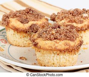 Crumb Cake Muffins - Three crumb cake muffins on a plate