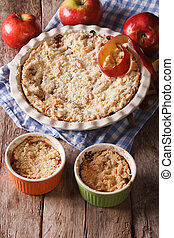 Crumble with apples close-up in baking dish. Vertical