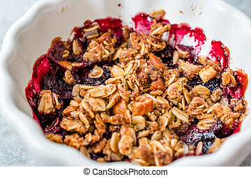 Crumble with Fresh Berries, Oatmeal, Nut, Flax Seeds and Granola.