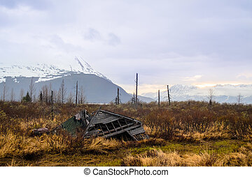Crumbled cabin - A view of a crumbling old cabin in Alaska's...
