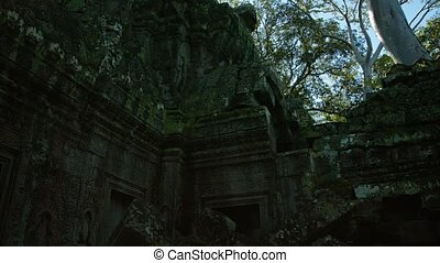 Crumbling facade and stone rubble of Ta Prohm Temple Ruin, an important site near Siem Reap, Cambodia. UltraHD video
