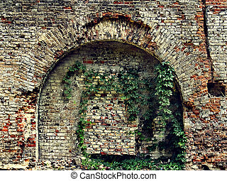 crumbling stone wall of an old house with brick masonry