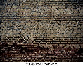 Old grunge crumbling brick wall