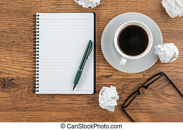 crumple paper, notebook and pen with cup of coffee