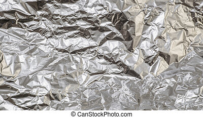 Crumpled aluminum foil texture background