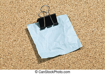 crumpled blue paper with clip