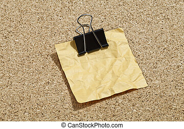 crumpled note with binder