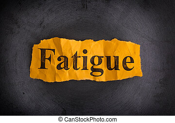 Crumpled piece of paper with the word Fatigue