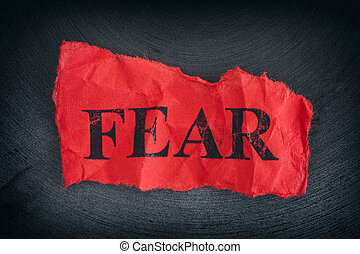 Crumpled piece of paper with the word Fear