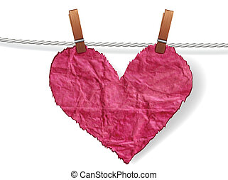 Crumpled  ragged heart attached to a clothesline with pin