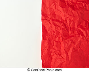 crumpled red paper on a white background