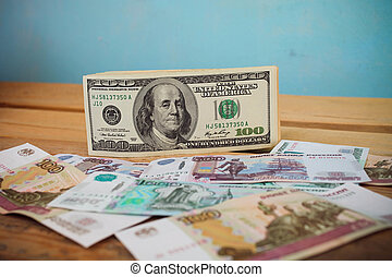 Crumpled scattered Russian rubles and dollars