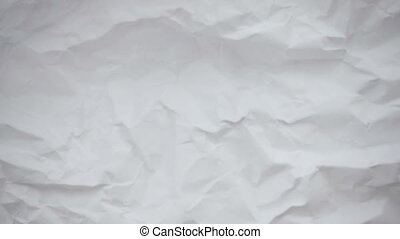Crumpled sheet of paper. Live wallpaper abstract background...