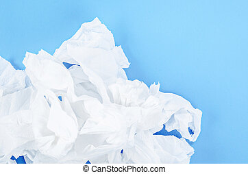 Crumpled tissue paper on blue background.