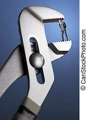 Crunch time - Business figurines in a clamp