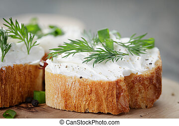 crunchy baguette slices with cream cheese and herbs